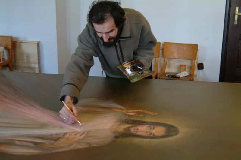 The artist Janusz Wacław Antosz finishes a new copy of the Divine Mercy image in Warsaw in 2008.