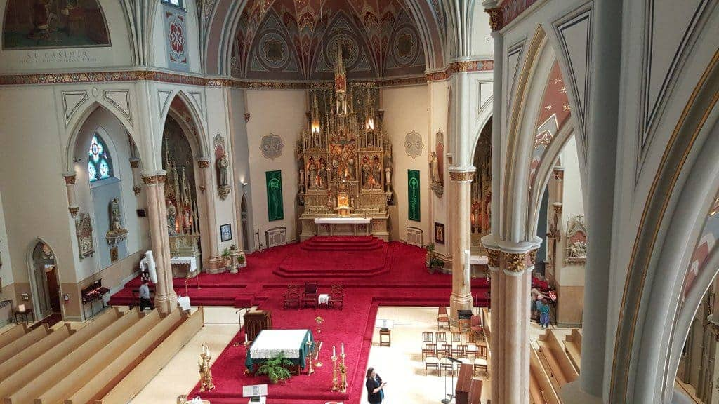 From the choir loft. Horrible, ugly reconfiguration of sanctuary and nave. Please restore to original layout.